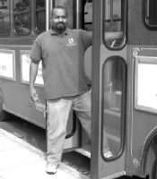CHUCK ROGERS/The AcornMASS TRANSIT IN STYLE - Trolley driver Andrew Fletcher pauses to board passengers at one of his regular stops at The Commons in Calabasas. The trolley makes regular trips between Calabasas City Hall and the shopping center on Fridays, Saturdays and Sundays. For detailed schedule information, visit or call city hall.