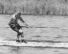 GRIPPING--Marshall Cole hangs on for dear life as he reaches speeds  up to 100 mph, sometimes faster, on his water skis.