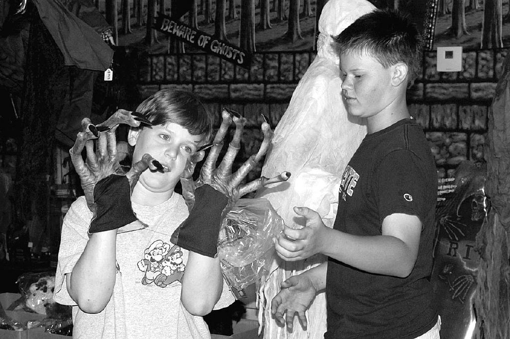 JANN HENDRY/Acorn Newspapers  'BROTHER, LEND ME A HAND'-Medea Creek Middle School siblings Conor, 11, left, and Brendan Miller, 13, enjoy Halloween fun at Confetti Halloween Shop in Agoura Hills. Confetti has two convenient locations: in Agoura Hills at 30317 Canwood Street (818) 879-4670 and in Janss Marketplace in T.O. at 325 Moorpark Road (805) 777-0049. Halloween arrives in 10 days.