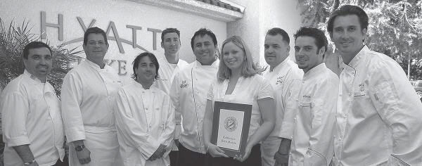 JANN HENDRY/Acorn Newspapers WHAT'S COOKING?—State Sen. Tom McClintock's district representative Allison Bonburg, center, presents  a certificate to area chefs meeting at the Westlake Hyatt Hotel in preparation for the Liver Foundation's Sept. 11 fundraising dinner. Chefs pictured are, left to right: Secret Garden's Michel Baldavid, Bellavino's Richard Hyman, Pierre's Catering Pierre Chapat, Roy's Tom Voss, Sherwood Country Club's Alberto Vazquez Bonberg, Hyatt Hotel's John Foerster, and Sheila's Place chefs Jeff Boullion and Gael Lecolley.