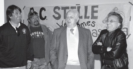 JANN HENDRY/Acorn Newspapers SWAPPING STORIES-  From left, A.C. Stelle teacher Derek Mena and school staffer Ray Ruiz enjoy a few laughs with former Dodger manager Tommy Lasorda and pop singer Frankie Valli during Lasorda's recent visit to the Calabasas middle school.