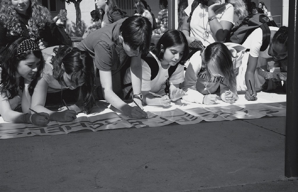 DARE TO BE KIND- A.E. Wright Middle School students sign a banner during a recent school assembly to launch