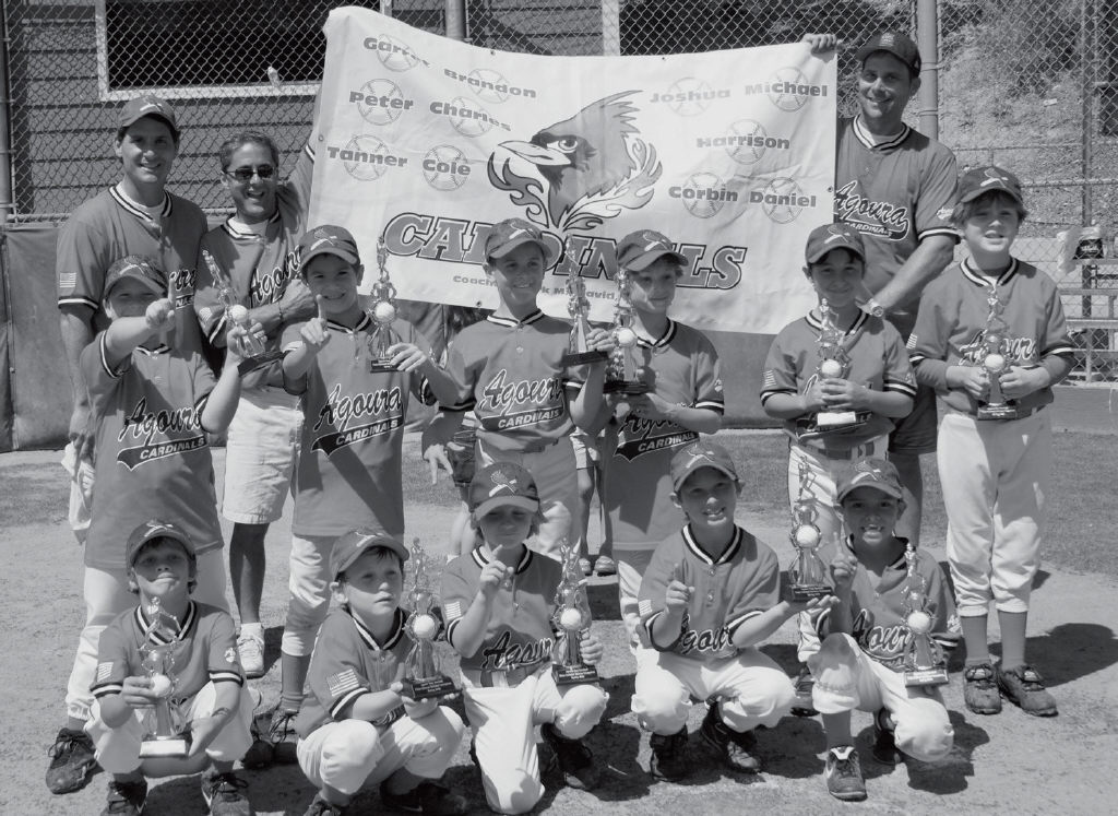 SOARING- The Cardinals, consisting of 7 and 8 year olds, went undefeated in the playoffs and became the 2008 Pinto National Champions for the Agoura Pony League. Pictured front row, from left: Charles Meissner, Harrison Jenkins, Garret Juels, Peter Weissman and Joshua Montoya. Middle row: Tanner Brodsky, Daniel Brandolino, Michael Chittenden, Brandon Nadell, Cole Hontas and Corbin Jenkins. Back row: Coach David Brandolino, coach Mark Hontas and manager Mark Meissner.