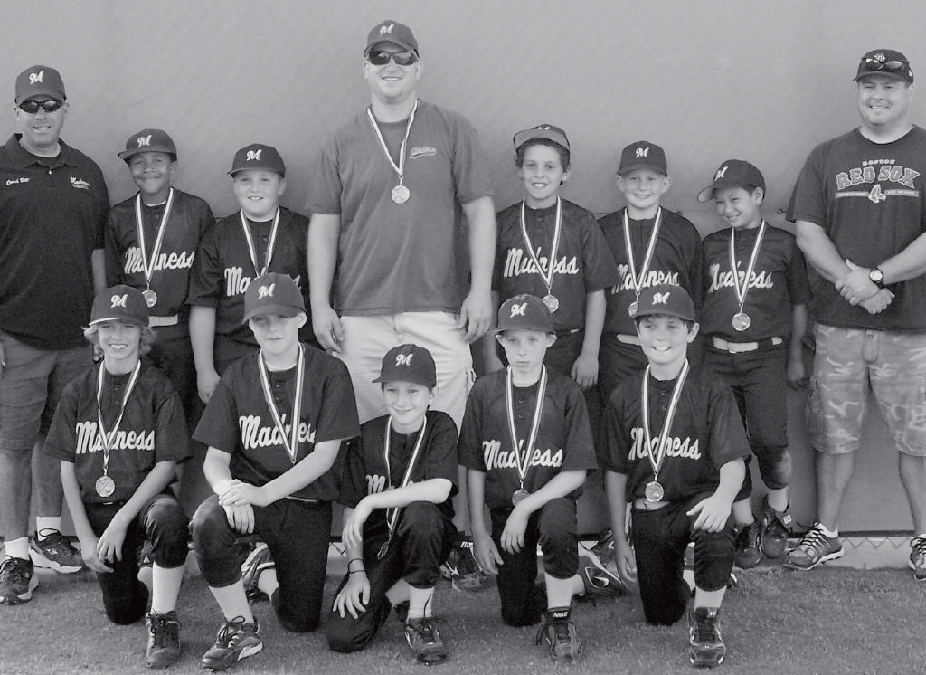 MADNESS ON THE DIAMOND- The Madness U-10 baseball team finished in second place at a tournament in Van Nuys earlier this month. Front row, from left: Grant Iwansky, Kobi Weisberg, Johnny Koonce, Alex Cutsforth and Colt Oder. Back row: Assistant coach Bill Murray, Myles Guy, Logan Finn, coach/ manager John Koonce, Max Friz, Eric Schaefer, Matthew Roth and assistant coach Dean Schaefer.