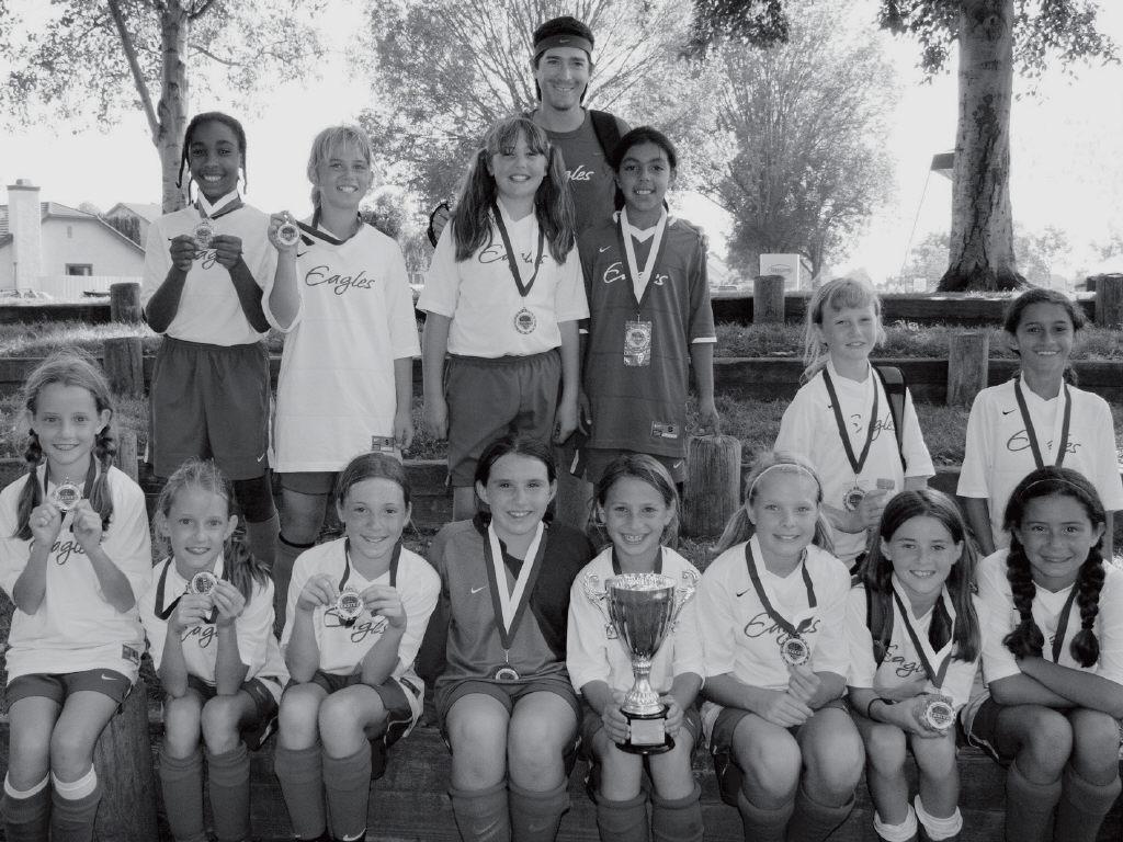 FLYING HIGH- The Eagles U-10 girls went undefeated and won the Eagles Classic. Front row, from left: Lindsay Greenblatt, Hayley Greenblatt, Taylor Corpuz, Jordyn Morris, Marisa