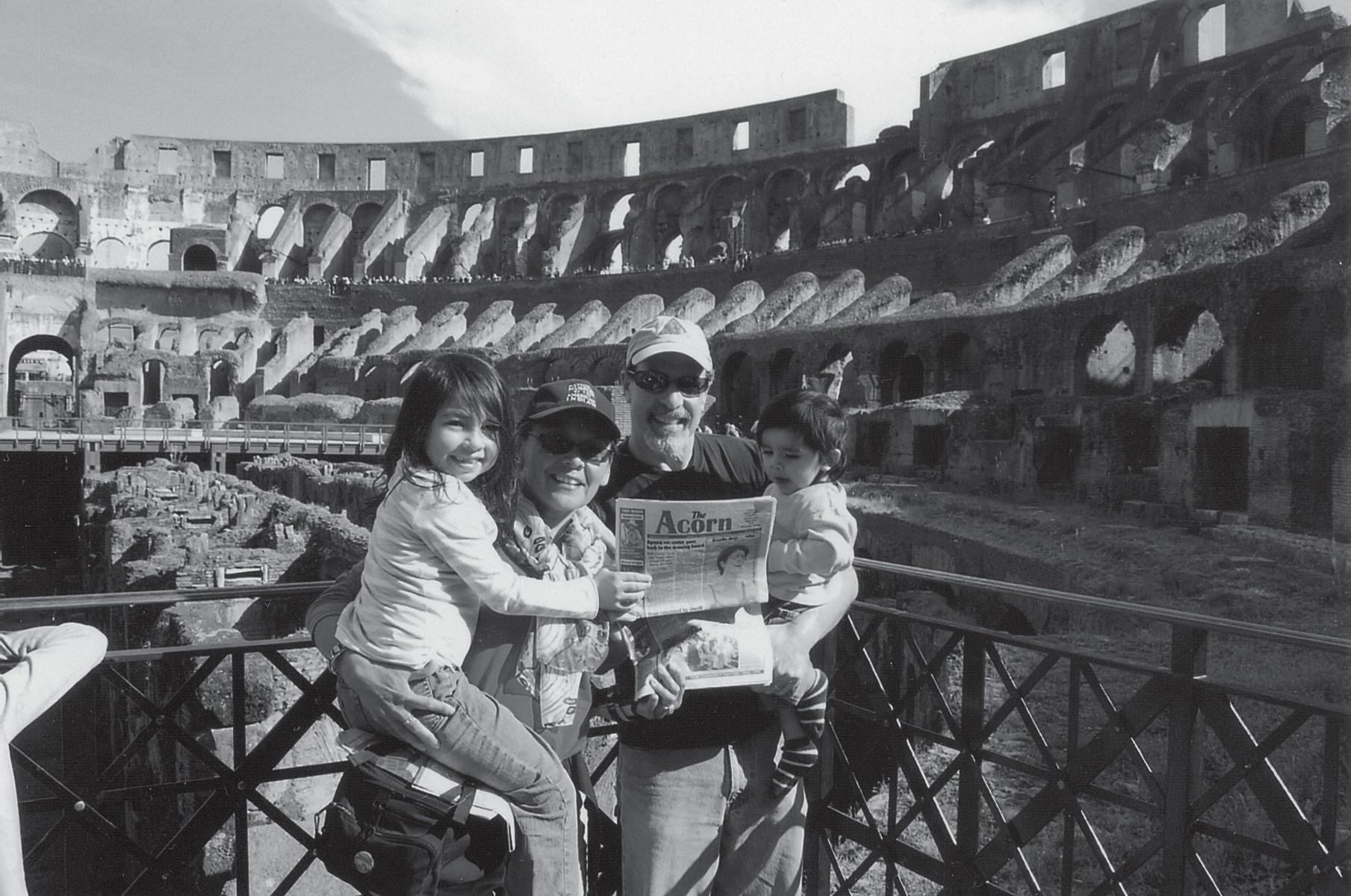 ANCIENT  AMPHITHEATER—Local  residents  hang  out  where  the gladiators once battled  at the ruins of the Coliseum in Rome. In the photo are Viktoria Larson-Green, Eva Larson, Michael Green and Ellis Green.
