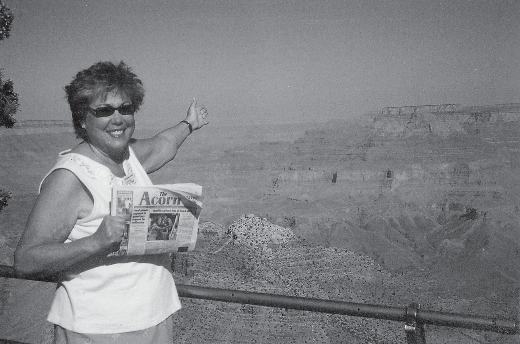 ISN'T  THIS  GRAND?—Donna  Cook  of  Calabasas  is  awed  by  he sweeping vistas of the Grand Canyon. She points the way down.