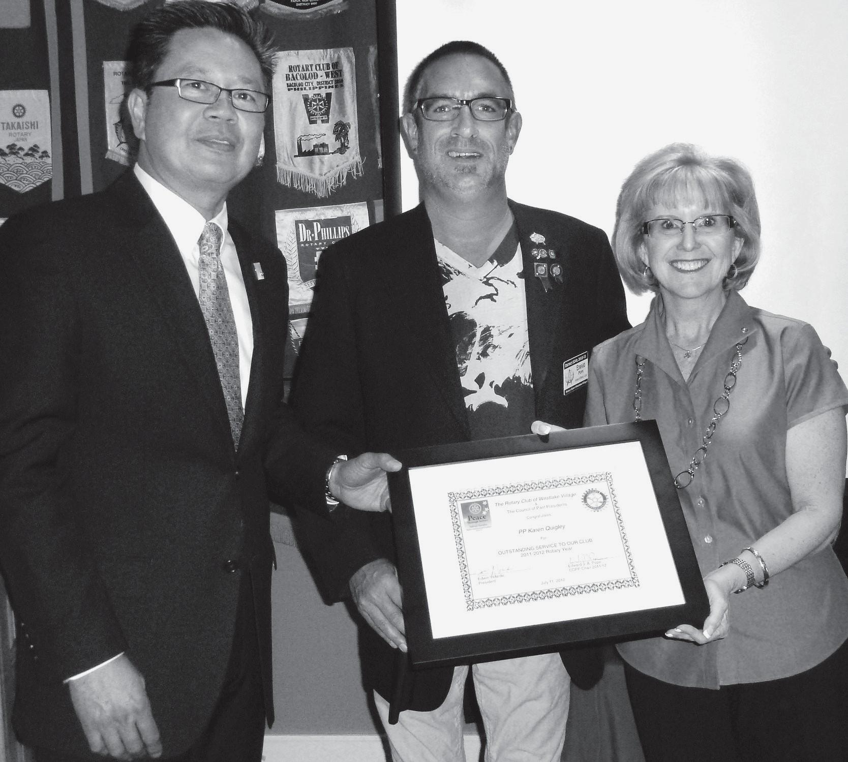 PASSING THE TORCH—New Westlake Village Rotary Club President Edwin Velarde joins past presidents Ed Pope and Karen Quigley.