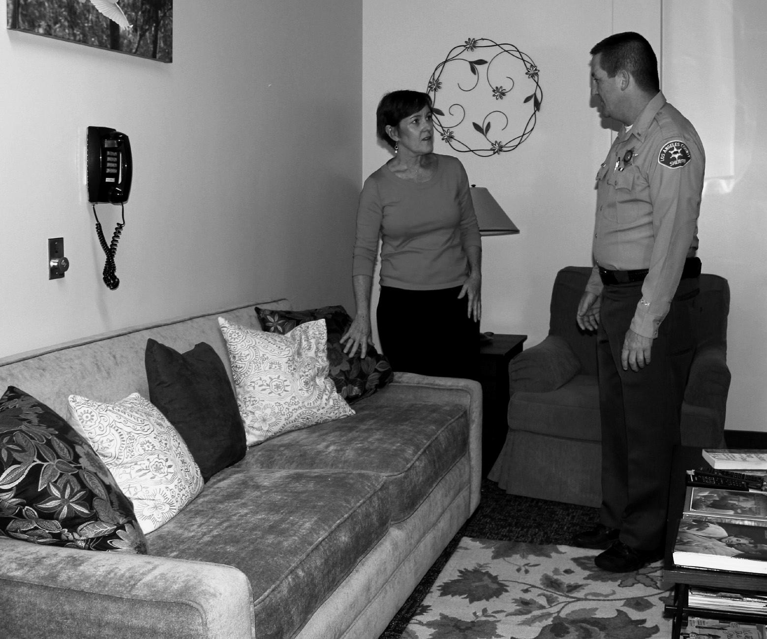 VISITING HOURS— Lt. Robert Wiard introduces Calabasas Mayor Mary Sue Maurer to the new Comfort Room inside the Lost Hills Sheriff's Station. The room was opened for the benefit of the public.