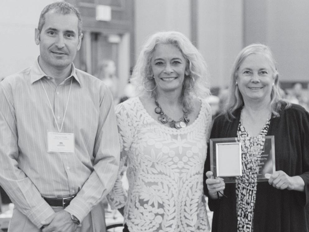TOP HONOR—Jean-Luc and Cyrena Nouzille, owners of Ladyface Ale and Brasserie in Agoura Hills, receive the Small Business of the Year Award from Sen. Fran Pavely, right, on June 16 in Sacramento.