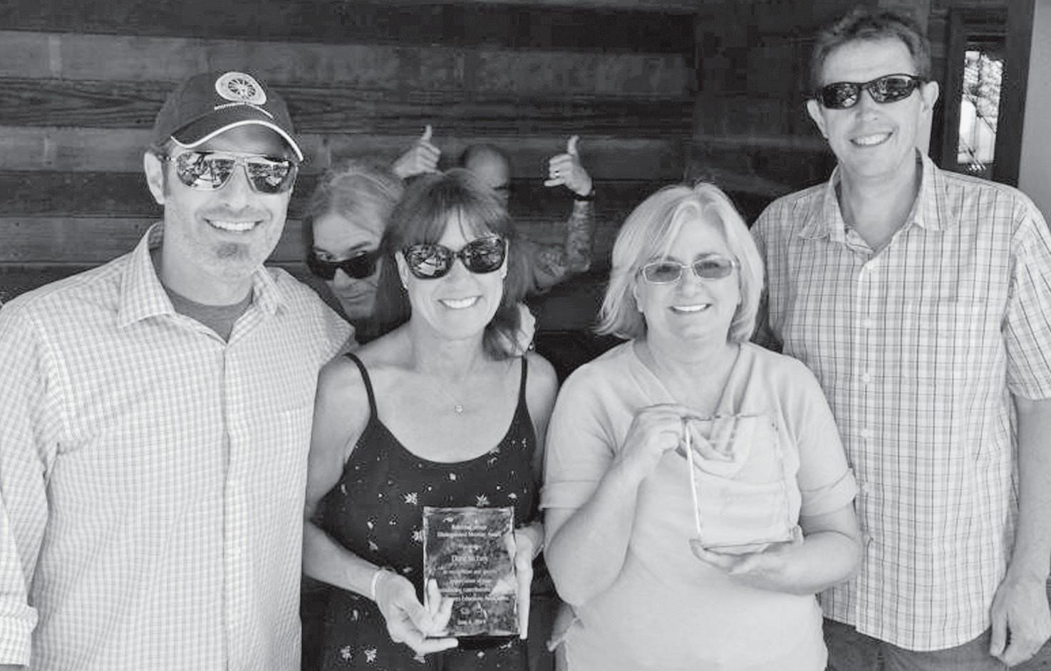 SUPPORTING EDUCATION—Co-presidents of the Las Virgenes Educators Association, Andrew Satinano, left, and Craig Hochhaus, right, present Calabasas High School teacher Diane McEvoy, center left, with the second annual Roberta Consani Distinguished Service Award and Acorn reporter Stephanie Bertholdo, center right, with the Sandi Pope Friend of Education Award.