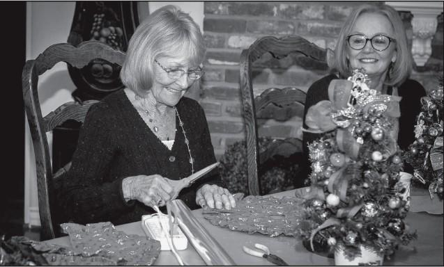 CREATING FOR CHARITY—Above, Jill Horan of Westlake Village, a member of the Assistance League of Conejo Valley, cuts tree skirts for tabletop Christmas trees that will be for sale at the upcoming Happy Holidays Happening fundraiser on Tues., Dec. 2. At right, fairies are the theme of one of the many trees that will be for sale at the event taking place at the Assistance League Thrift Shop, 783 E. Thousand Oaks Blvd., T.O. Hours are 10 a.m. to 3 p.m. Tuesday through Saturday. For more information, call (805) 379-5686 or visit www.alcv.org.