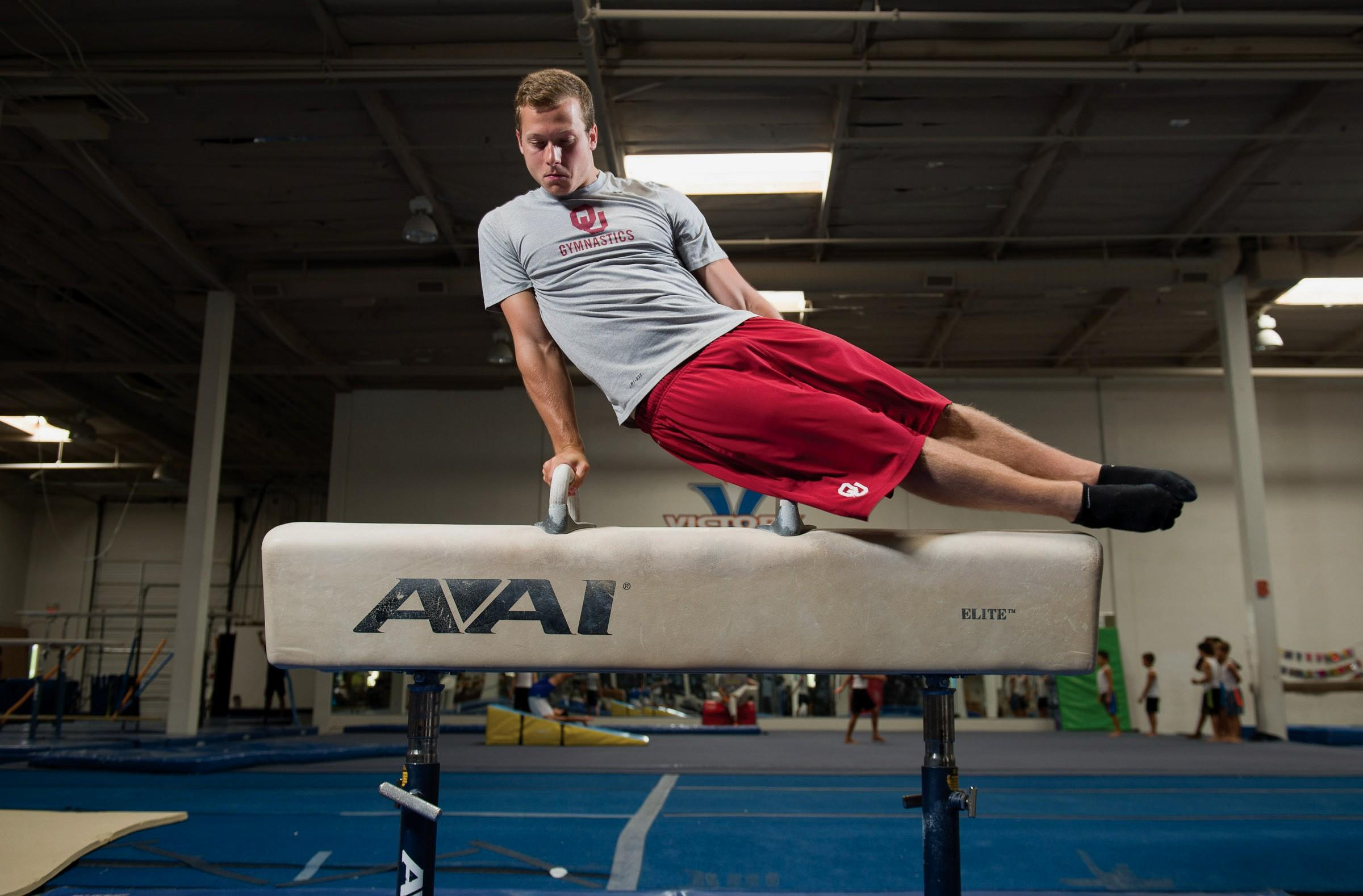 HORSING AROUND—Alec Robin does a short routine on the pommel horse at Victory Gymnastics Academy in Newbury Park on Tuesday. Robin will study dentistry at the University of Pennsylvania.