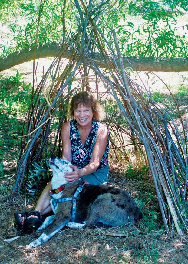 A MAGICAL SPOT—The writer and her dog visit the wickiup in the willow wood.