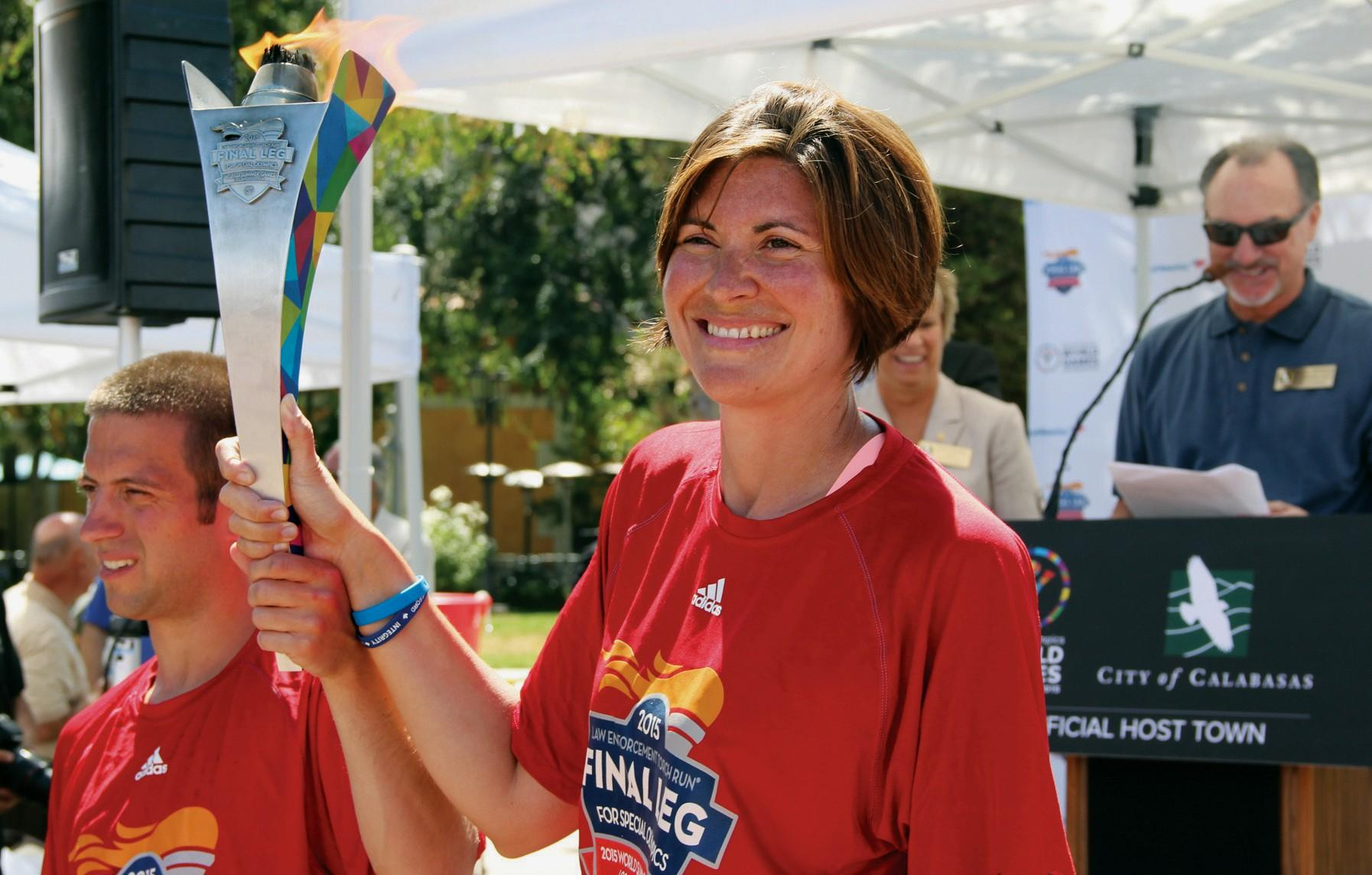 FINAL LEG—Jennifer Riley, an officer with the Delaware Department of Corrections, and athlete Joshua Norris lead the torch run at Calabasas City Hall on July 17.