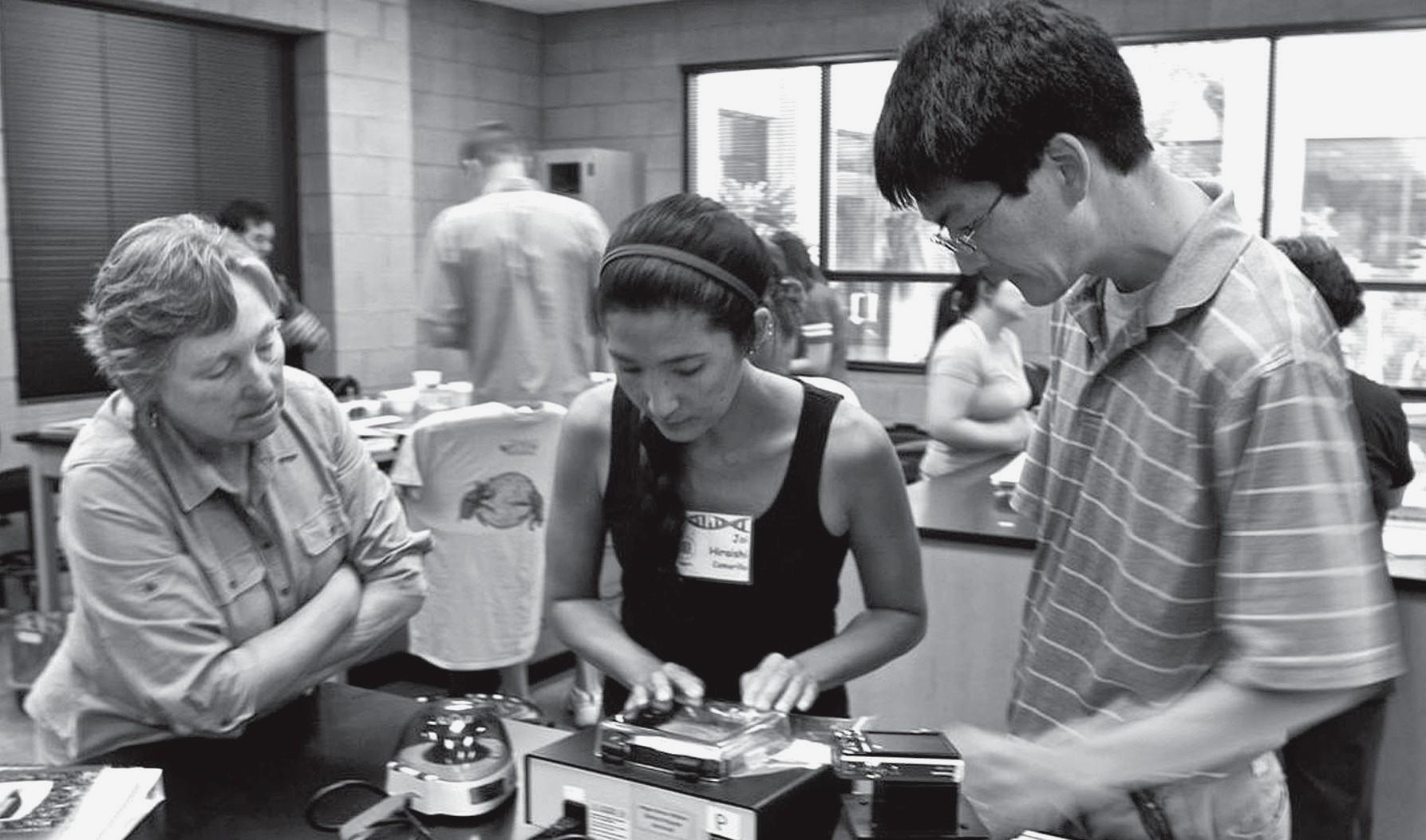 BIOTECH RULES—Camarillo High science teacher Joi Hiraishi, center, learns about the new equipment last year.