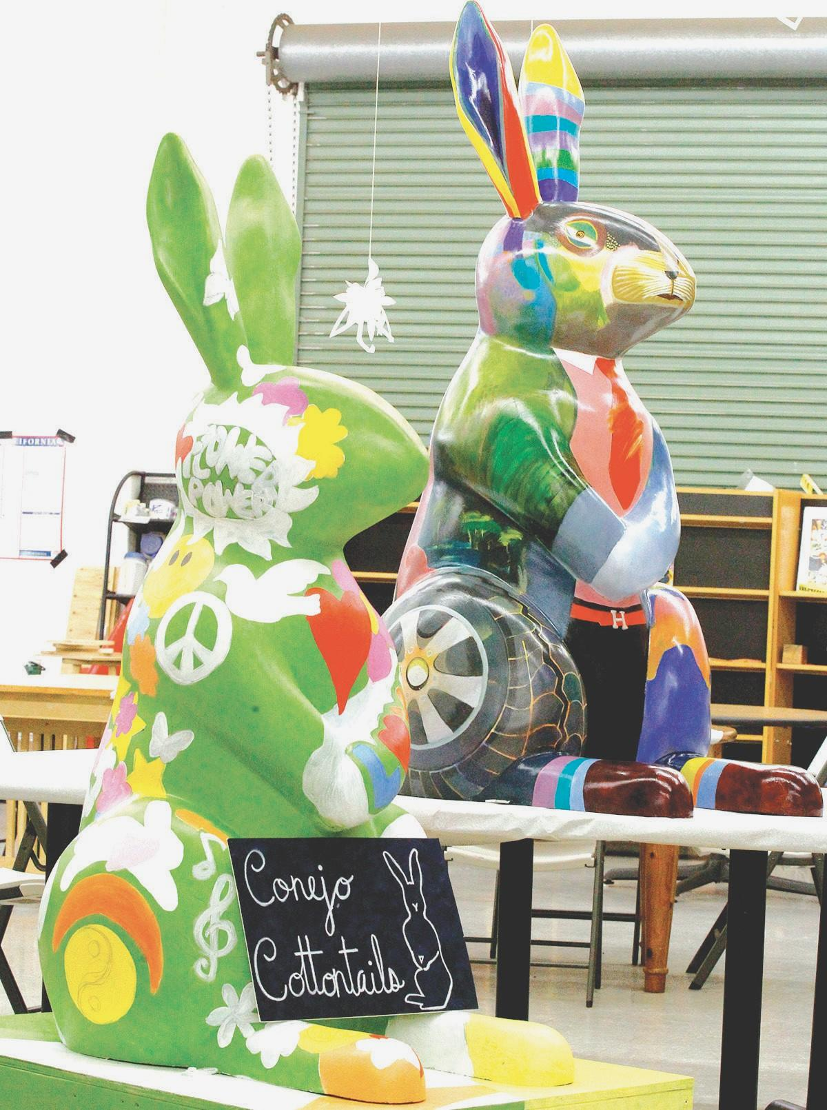 HARE TODAY, GONE TOMORROW—Two Conejo Cottontails await their fates at Art Trek in Newbury Park. Cate Hartenstein painted the unfinished rabbit on the left. Hessan Abrishami decorated the other.