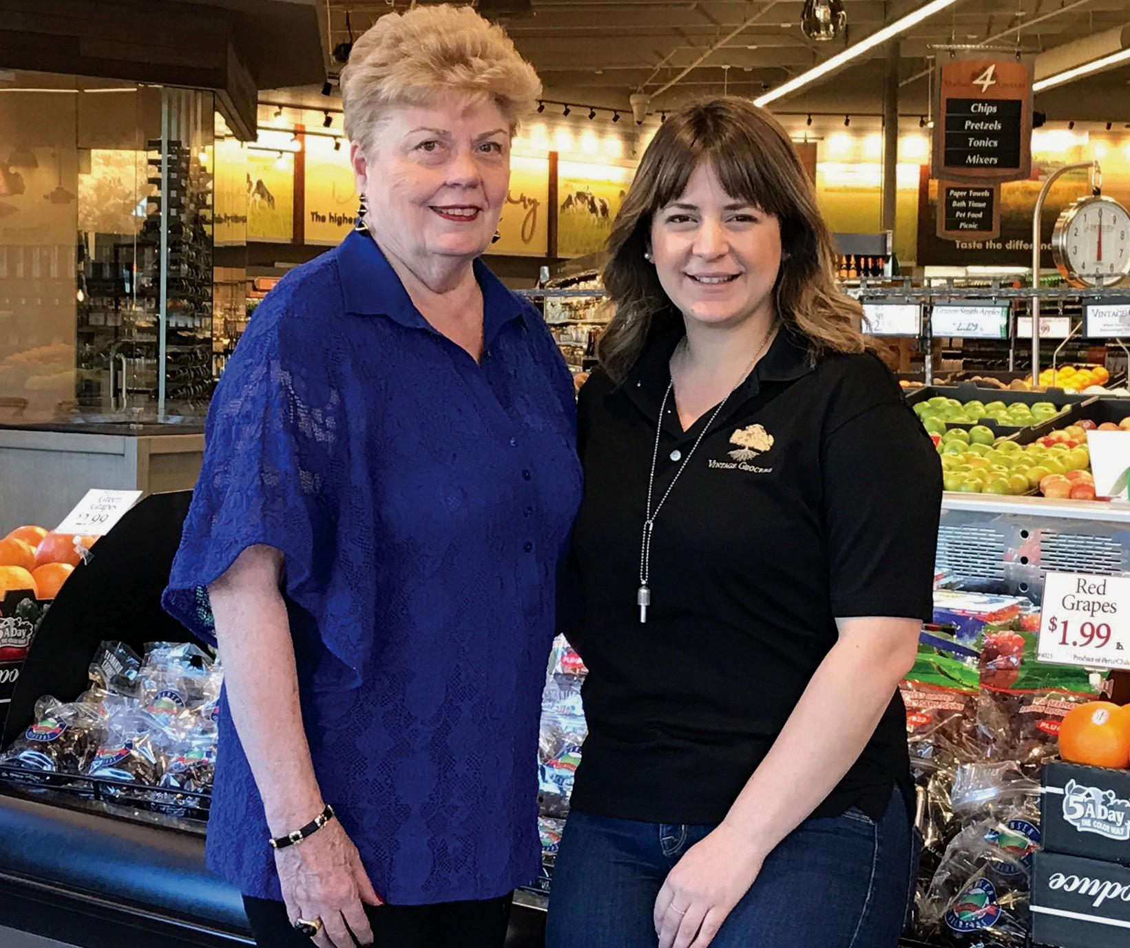 SAVE THE DATE—Judy Doane, president of Westlake Village Garden Club, and Mary Carbonniere of Vintage Grocers at The Promenade are promoting the club's annual garden tour set for Sun., April 23.