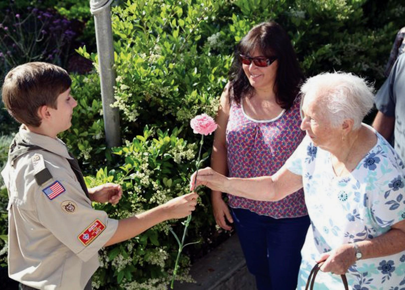RESPECT—Boy Scout Patrick Mrachek greets the moms and grandmothers during a previous pancake breakfast at Malibou Lake. The event not only honors the ladies, it's also a major fundraiser for the Scouts.